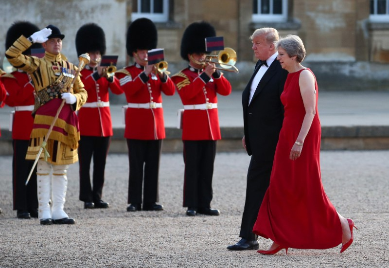 British Prime Minster Theresa May and U.S. President Donald Trump walk across the courtyard at Blenheim Palace near Oxford