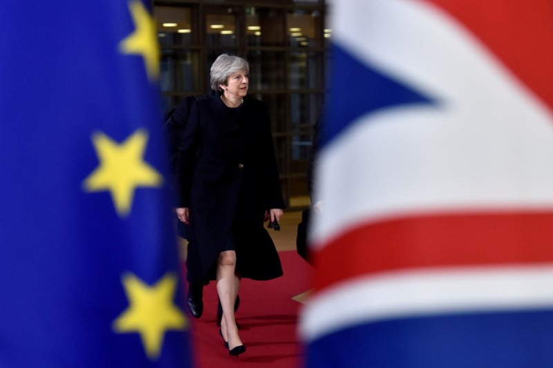 FILE PHOTO: British PM May arrives for the EU summit in Brussels