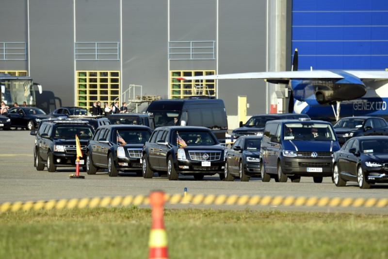 Motorcade waits for the arrival of U.S. President Trump on the tarmac of the Helsinki International Airport in Vantaa,