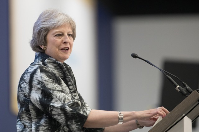 Britain's Prime Minister, Theresa May speaks at the Farnborough Airshow, in Farnborough
