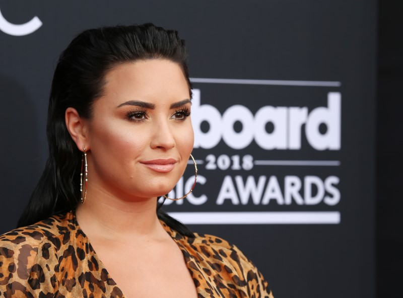 Demi Lovato hospitalized after reported overdose, TMZ reports