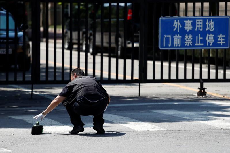 Security personnel is seen near the U.S. embassy in Beijing