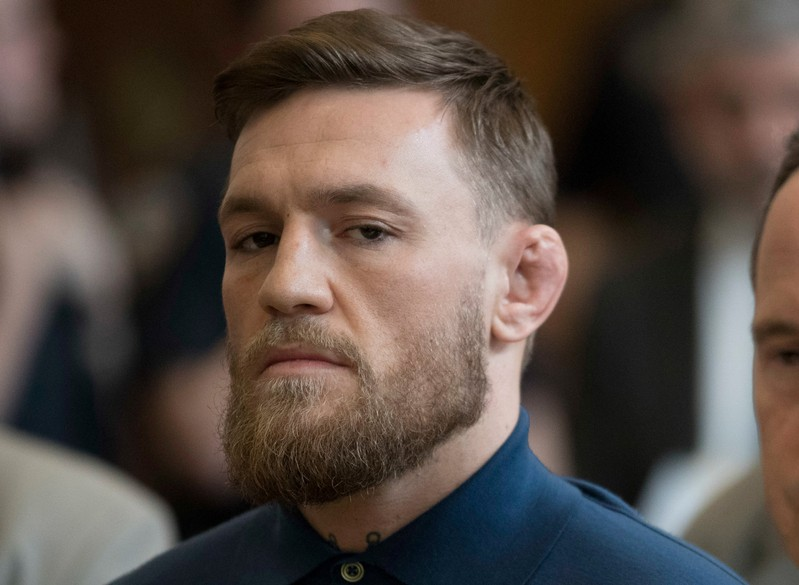 FILE PHOTO: Mixed martial arts fighter Conor McGregor stands during his arraignment in a New York City courtroom on charges of assault in New York