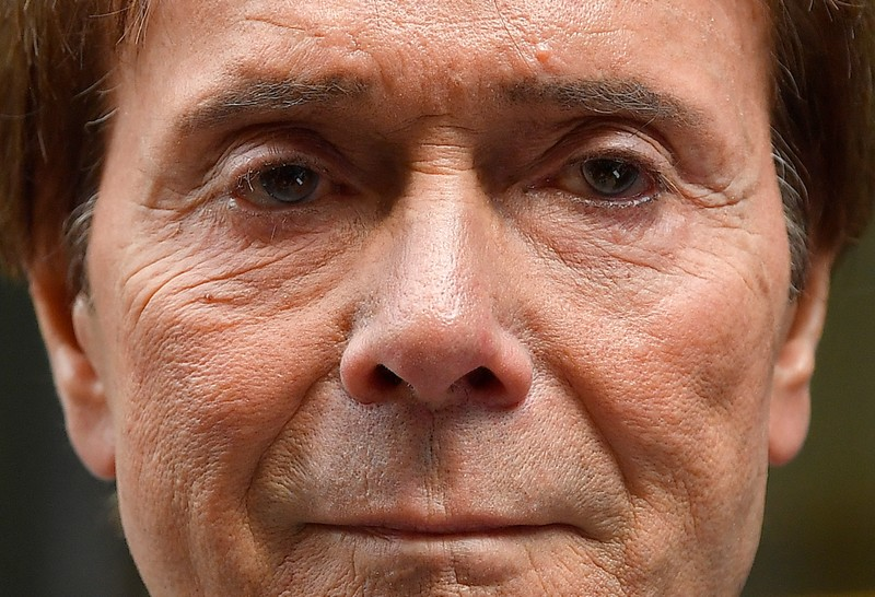 Singer Cliff Richard leaves the High Court after the court found in his favor in the privacy case he brought against the BBC, in central London