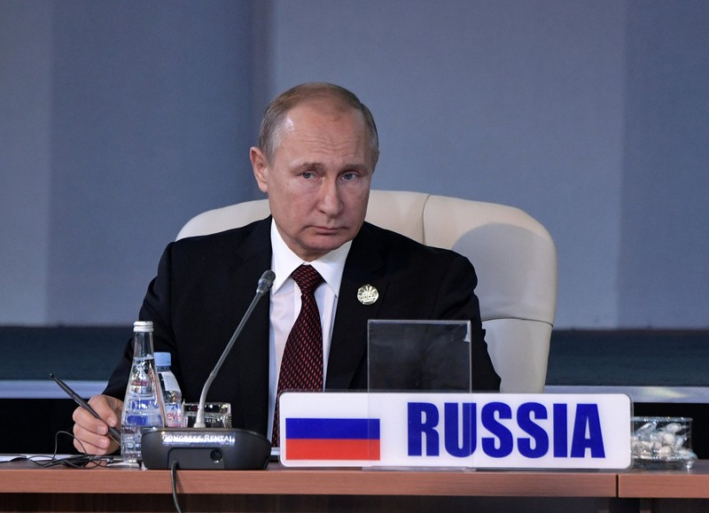 Russian President Putin attends a session of the BRICS summit in Johannesburg