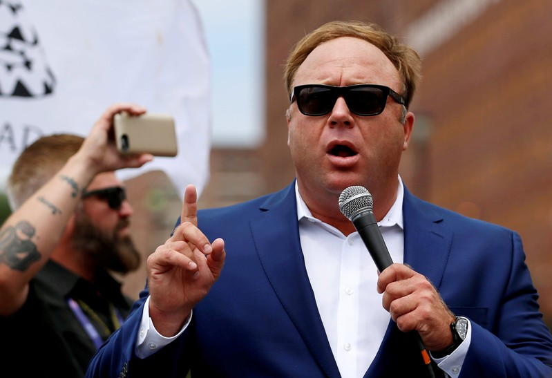FILE PHOTO: Alex Jones from Infowars.com speaks during a rally in support of Republican presidential candidate Donald Trump near the Republican National Convention in Cleveland