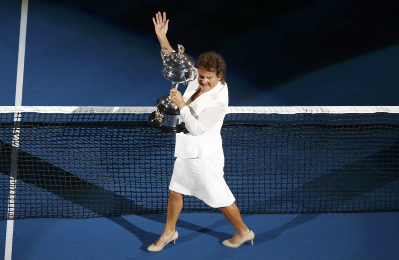 FILE PHOTO: Former tennis player Goolagong-Cawley arrives with the women's singles trophy before the final match between Williams of the U.S. and Germany's Kerber at the Australian Open tennis tournament at Melbourne Park