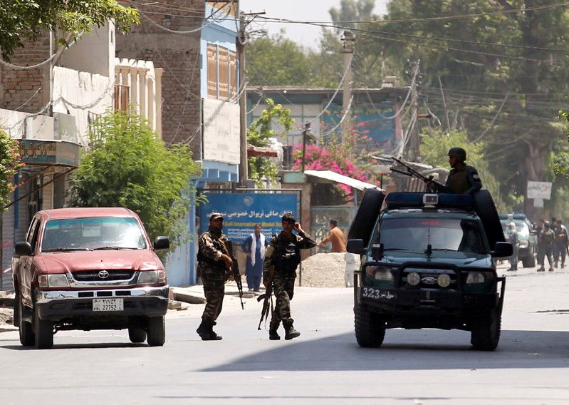 Afghan security forces arrive at an area where explosions and gunshots were heard, in Jalalabad city