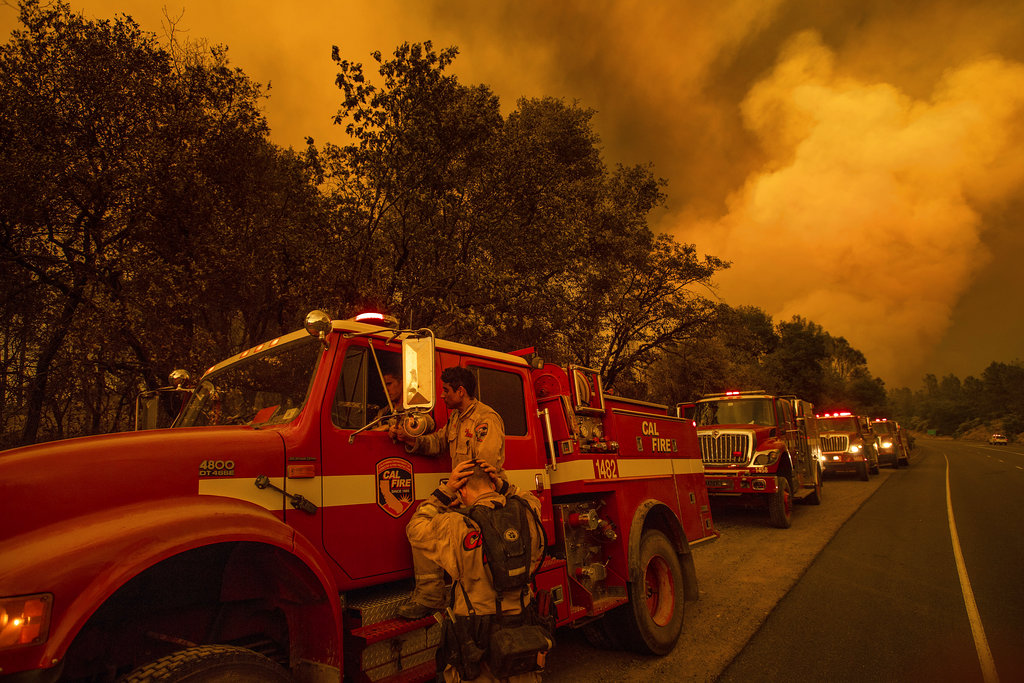 California wildfire kills 1, burns firefighters