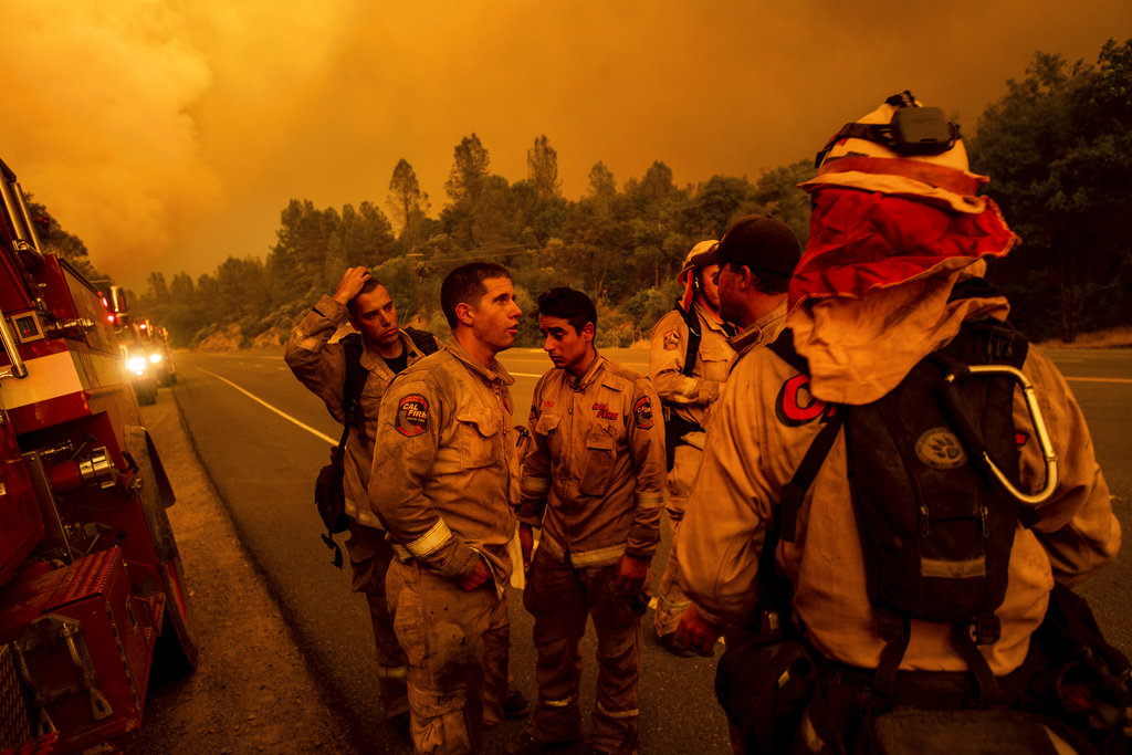 Firefighters discuss plans while battling the Carr Fire in Shasta Calif. on Thursday