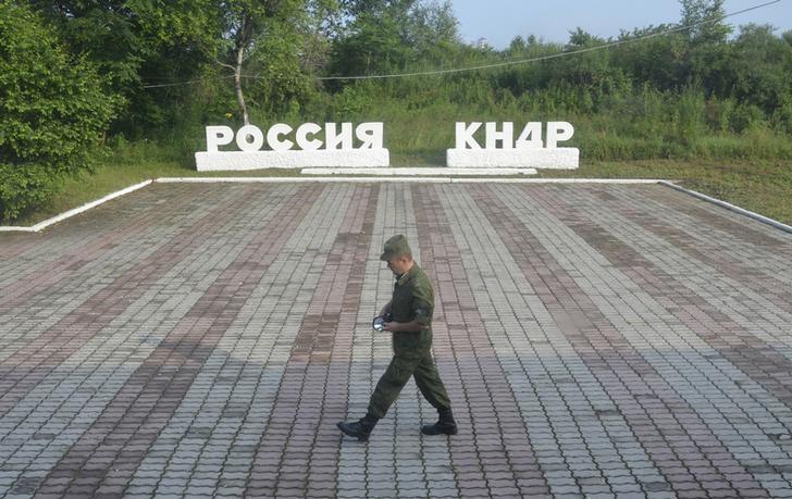 FILE PHOTO: A guard walks along the platform at the border crossing between Russia and North Korea at the North Korean settlement of Tumangan
