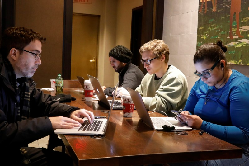 FILE PHOTO:  Customers use the internet at a Starbucks in the financial district in New York
