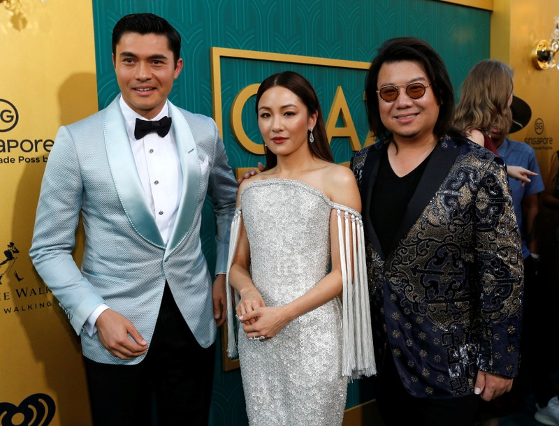 Author Kwan and cast members Golding and Wu pose at the premiere for