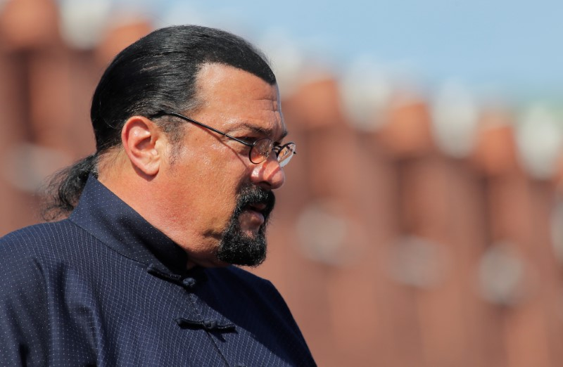 FILE PHOTO: U.S. actor Steven Seagal watches the Victory Day parade at Red Square in Moscow