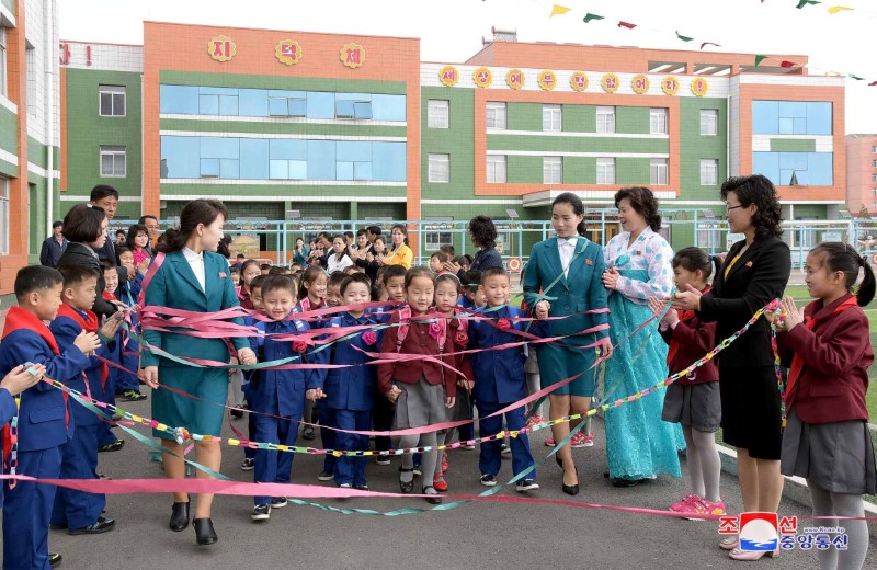FILE PHOTO Students take part in a ceremony as the new school year begins in North Korea