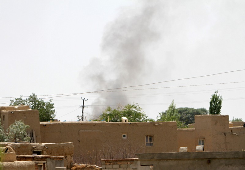 Smoke rises from a residential area where gun battle is going on between Taliban and Afghan forces in Ghazni province