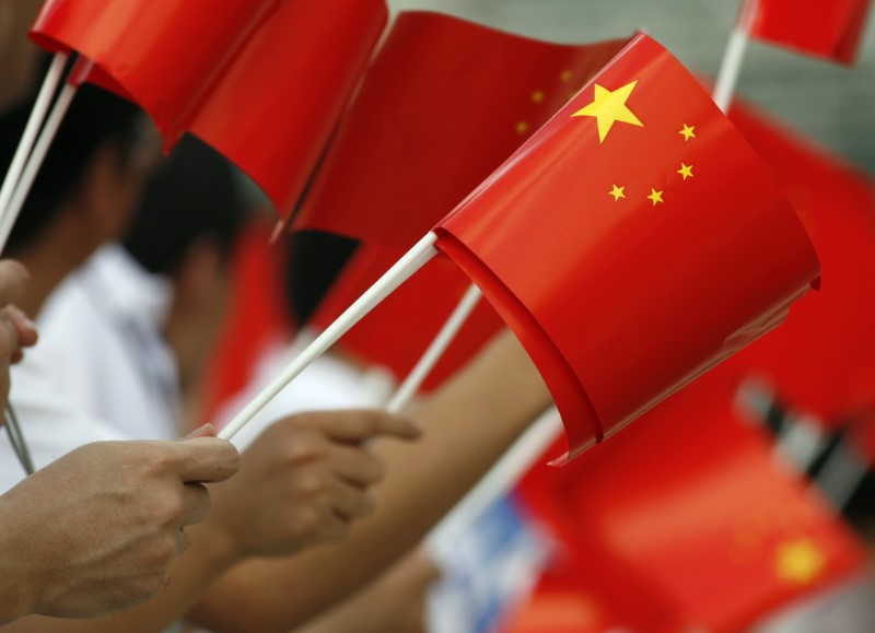 Supporters wave Chinese flag in Jakarta