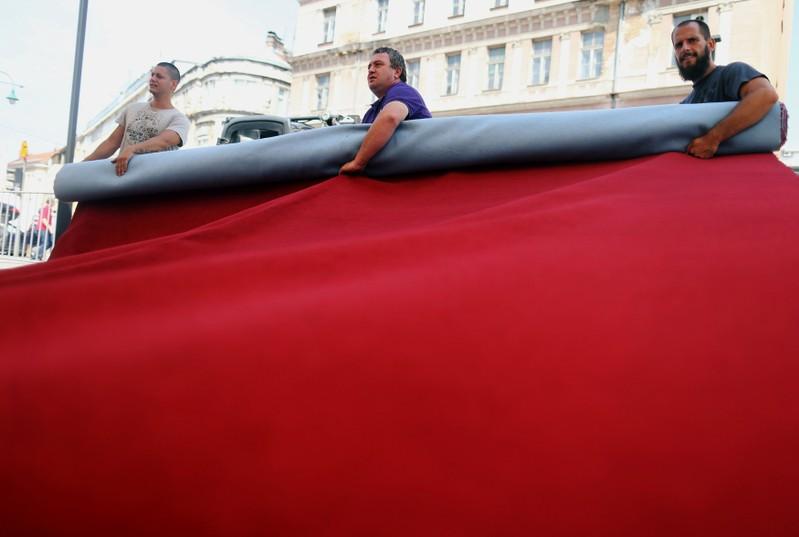 Workers prepare the red carpet for 24th Sarajevo Film Festival in Sarajevo