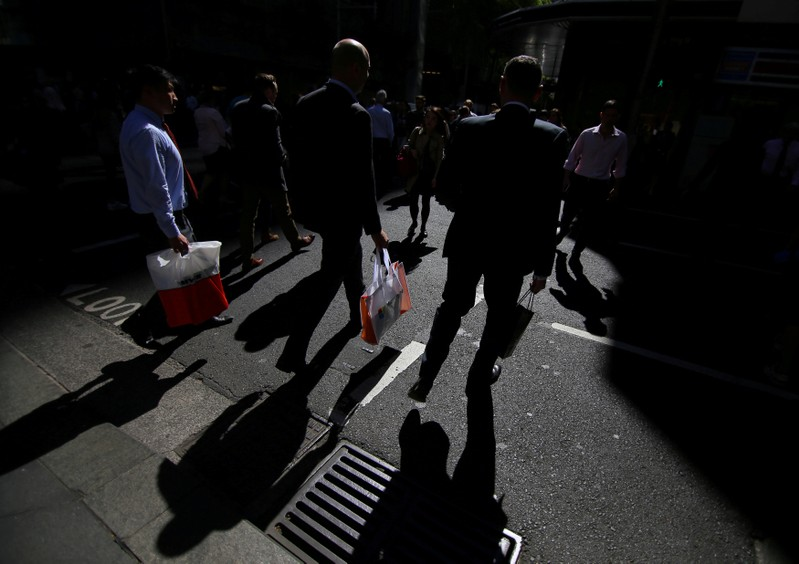 FILE PHOTO: Workers walk on the streets of Sydney, Australia