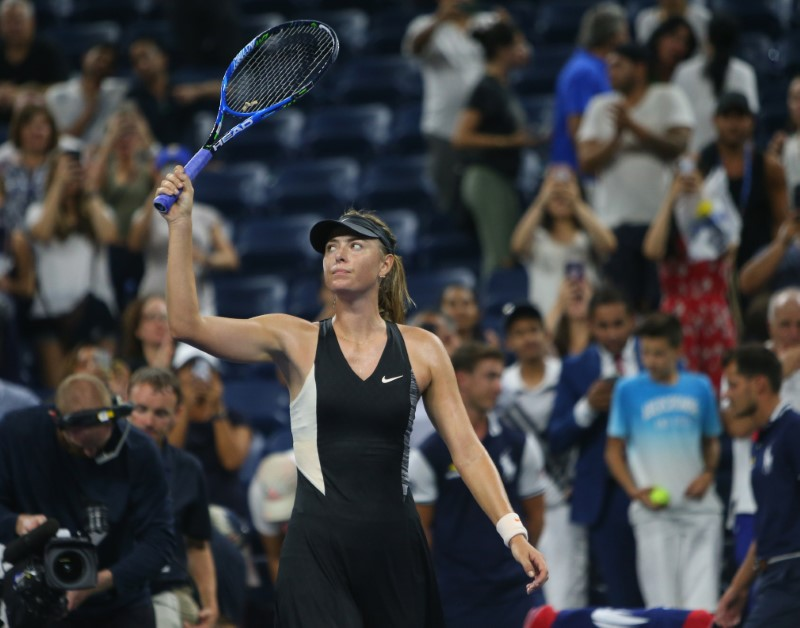 Sharapova overcomes spirited Schnyder to reach US Open second round
