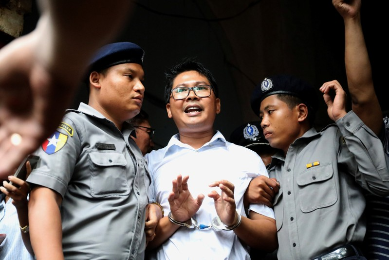 Myanmar court jails Reuters reporters over breach of