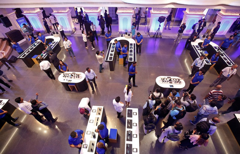 Staff members give media personnel a guided tour of the newly opened Samsung store in Bengaluru