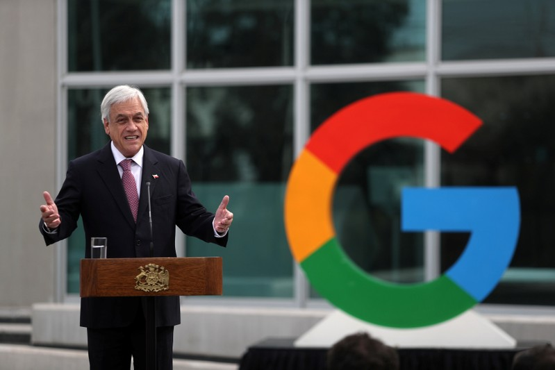 Chile's President Sebastian Pinera delivers a speech near a Google logo during the announcement of the plans for their data centre expansion in Santiago