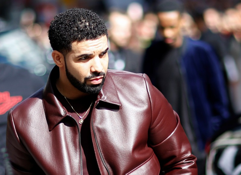 Drake arrives on the red carpet for the film