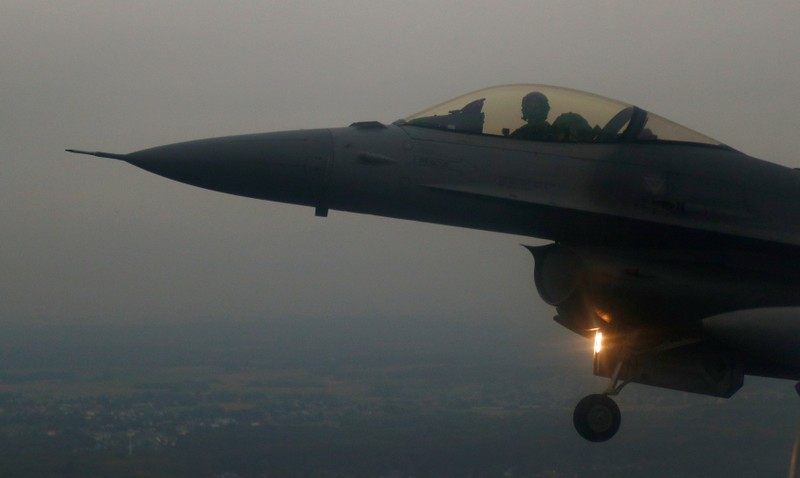 A Belgian F16 fighter plane demonstrates the interception of an air force transport plane as they fly over Belgium
