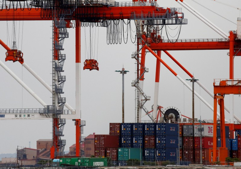 Containers are seen at an industrial port in the Keihin Industrial Zone in Kawasaki