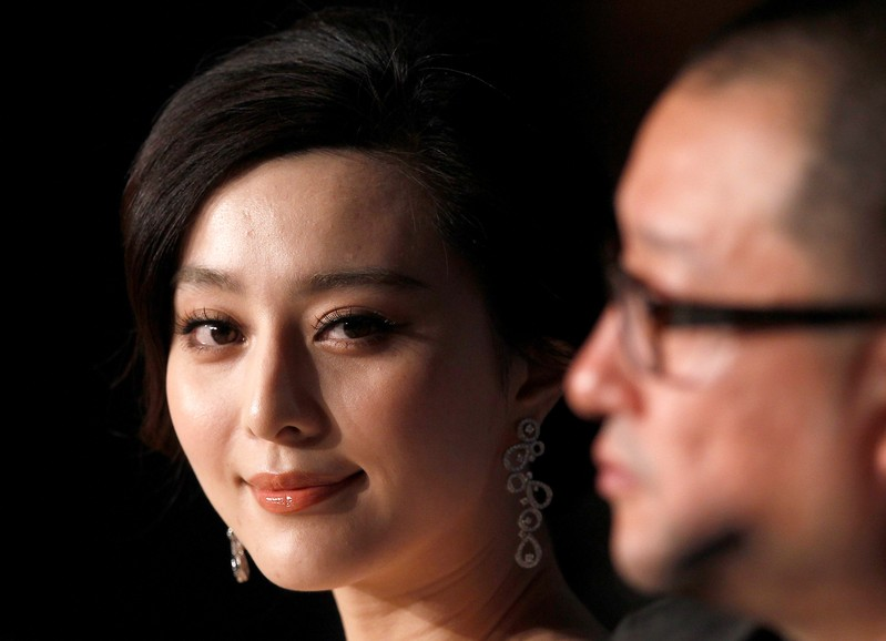 FILE PHOTO: Director Wang and cast member Fan attend a news conference for the film