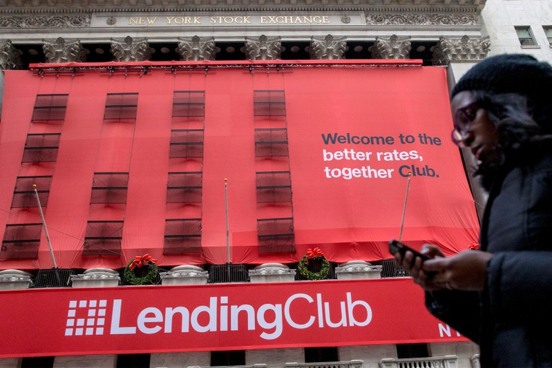 File photo of a woman passing by a Lending Club banner on the facade of the the New York Stock Exchange