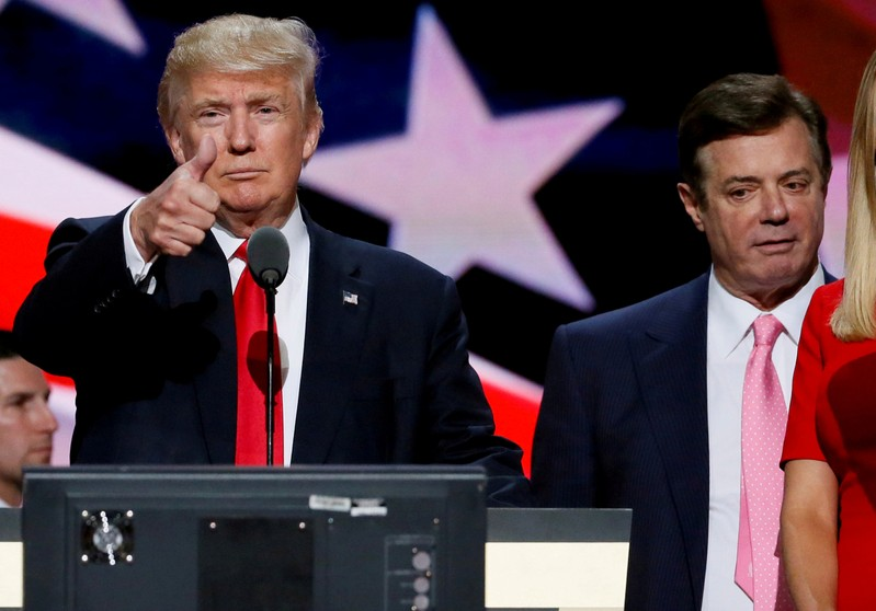 FILE PHOTO: Republican presidential nominee Donald Trump gives a thumbs up as his campaign chairman Paul Manafort looks on during Trump's walk through at the Republican National Convention in Cleveland