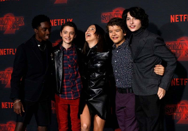 FILE PHOTO: Cast members McLaughlin, Schnapp, Brown, Matarazzo and Wolfhard pose at the premiere for the second season of the television series