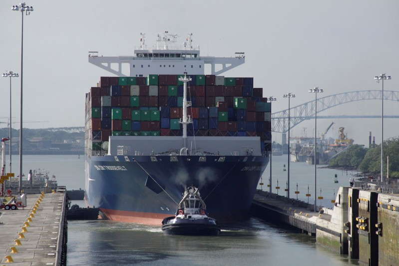 FILE PHOTO: Tugboat tows the British CMA CGM T. Roosevelt cargo vessel at Panama Canal