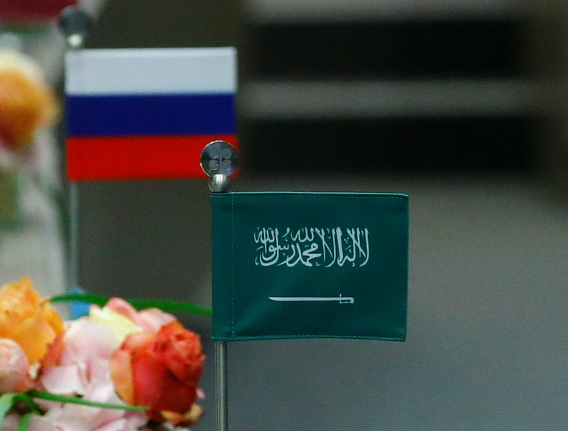 The national flags of Russia and Saudi Arabia are seen during an OPEC meeting in Vienna