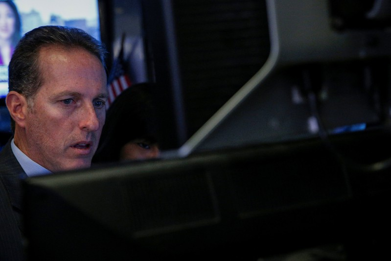 A specialist trader works on the floor of the NYSE in New York
