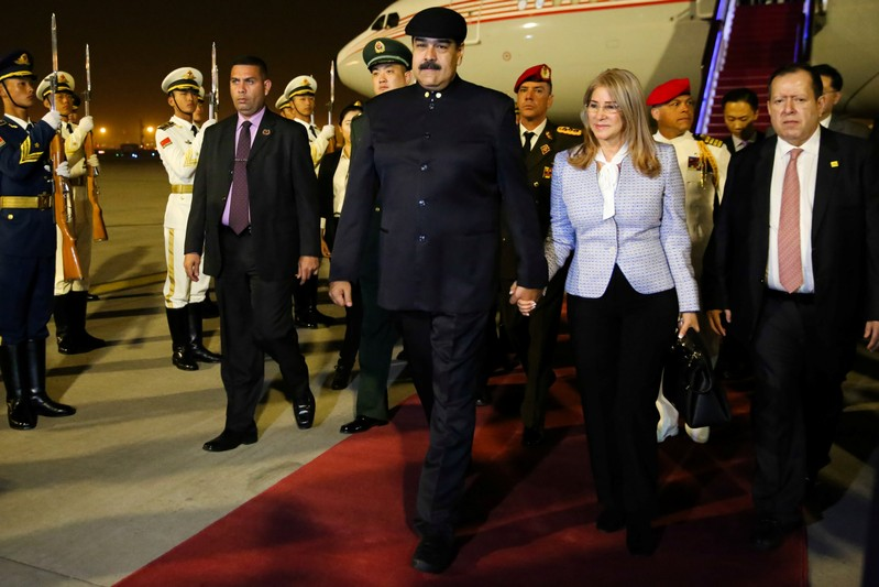 U.S. sanctions Venezuela officials, Trump slams Maduro