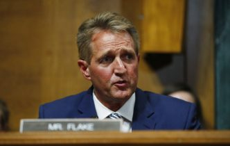 Sen. Jeff Flake, R-Ariz., speaks before the Senate Judiciary Committee hearing asking about a further investigation
