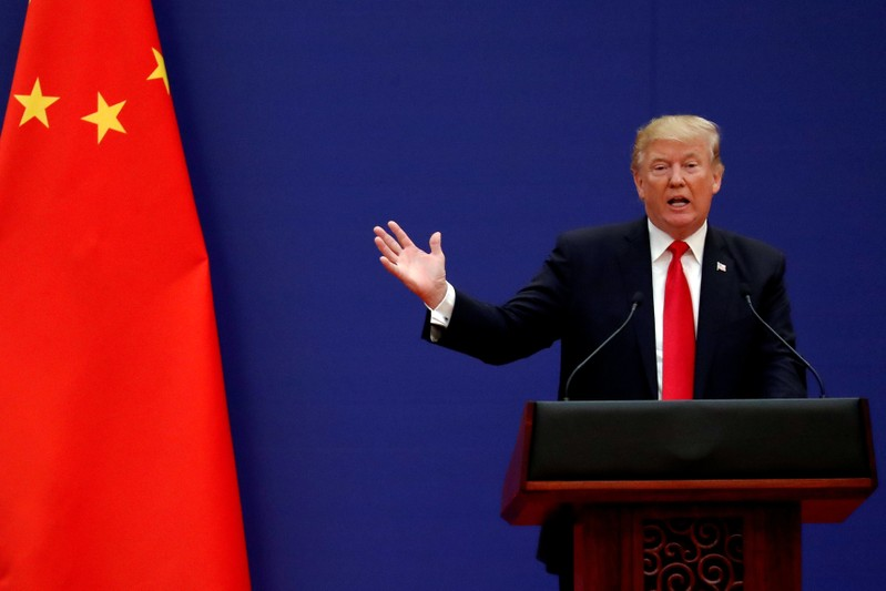 FILE PHOTO: U.S. President Donald Trump delivers his speech as he and China's President Xi Jinping meet business leaders at the Great Hall of the People in Beijing