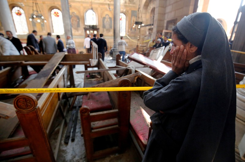 FILE PHOTO: A nun cries at the scene of the bombing inside Cairo's Coptic cathedra