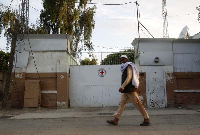 A man walks past the front gate of the International Committee of the Red Cross (ICRC) office in Jalalabad province