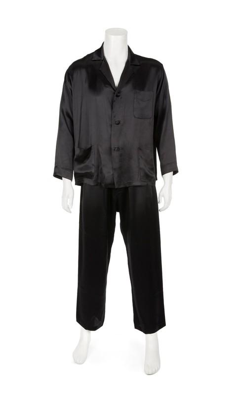 Hugh Hefner Julien's Auctions image of Playboy founder Hugh Hefner's trademark black silk pajamas from Hugh Hefner collection going up for sale