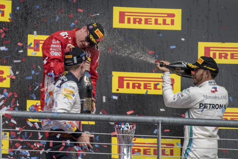 Hamilton's title hopes boosted by Vettel's grid drop