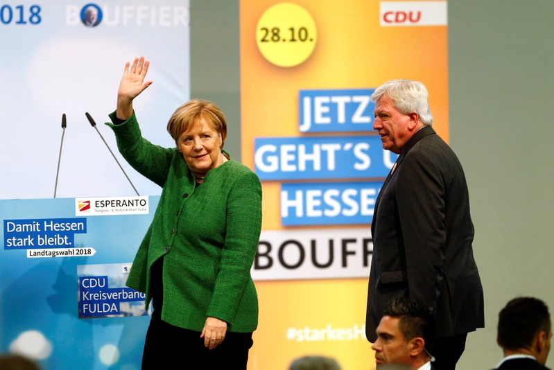Prime Minister Volker Bouffier and German Chancellor Angela Merkel attend the final campaign rally prior to the upcoming state election in Fulda