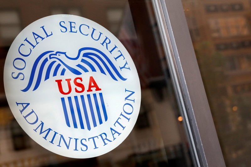 FILE PHOTO: FILE PHOTO Sign is seen on the entrance to a Social Security office in New York