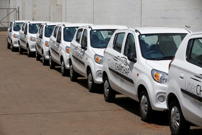 Suzuki cars branded with Uber stickers are seen in a showroom in Nairobi