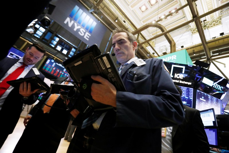 Traders work on the floor at the New York Stock Exchange (NYSE) in New York City