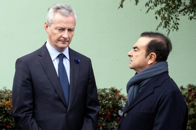 Bruno Le Maire and Renault CEO Carlos Ghosn wait for French President Emmanuel Macron for a visit of the Renault factory in Maubeuge