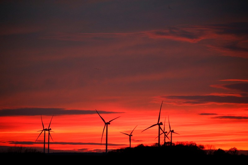 Power-generating windmill turbines are pictured at sunset at a wind park in Moeuvres near Cambrai